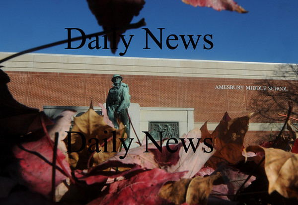 Amesbury: Leaves waiting to be raked cover the lawn in front of the Amesbury Middle School framing the doughboy statue on a warm fall aSunday afternoon. Jim Vaiknoras/Staff photo