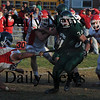 West Newbury: Maconomet's Yoshio Yabe hangs on to Pentucket running back Peter  Koopman by a threads during their game at Pentucket Saturday. Jim Vaiknoras/Staff photo