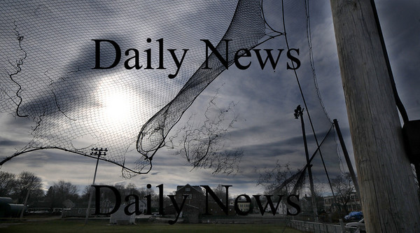 Newburyport: The netting at the softball field at Cashman Park in Newburyport blows free in the high winds Saturday. Jim Vaiknoras/Staff photo