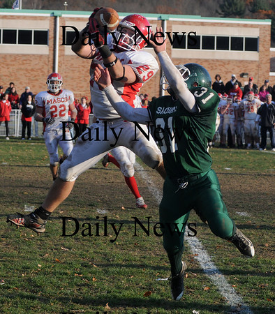 West Newbury:Masconomet's Jake Lawrence intercepts a pass intended for  Pentcuket's Austin Perreault during their game Saturday at Pentucket. Jim Vaiknoras/Staff photo