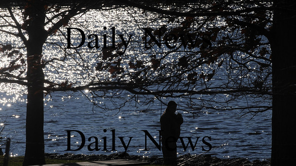 Amesbury: A fisherman tries his luck in the early morning sunshine in Alliance Park Subnday morning.Jim Vaiknoras/Staff photo