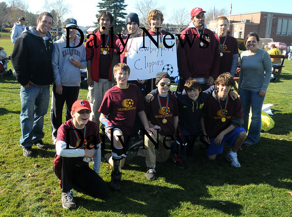 Byfield:The Newburyport Clippers Special Olympics soccer team poses for a group picture after their game Sunday morning. They were one of 115 teams at the annual State Soccer Tournament, Sunday, November 8 at GovernorÕs Academy in Byfield