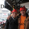 Newburyport: Shari Wilkinson and David Hall don elf hats at the Tannery . The hats are part of a fundraiser . Jim Vaiknoras/Staff photo