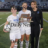 Lynn: The Georgetown girls soccer Capts Casey Decareau and Emma Cannon and coach Colleen Gibbs pose with their trophy after winning the North Sectional by defeating Lowell Tech at Manning Field in Lynn Sunday afternoon. jim Vaiknoras/Staff photo