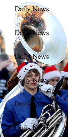 Newburyport: The Triton high school band sousaphone player Tom Kuczun marches in the annual Newburyport Parade and Tree Lighting Sunday night in Market Square. Jim Vaiknoras/Staff photo