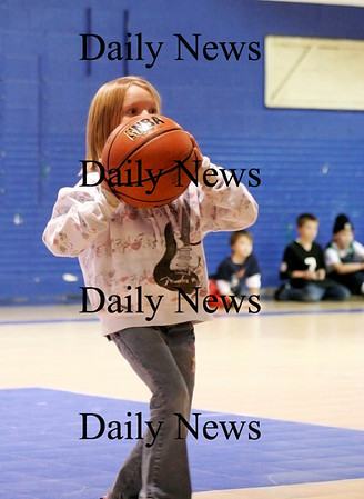 Salisbury: Noel Murphy, 7, of Salisbury, participates in the NBA Fit Challenge at the Salisbury Boys and Girls Club Thursday afternoon. Photo by Ben Laing/Staff Photo