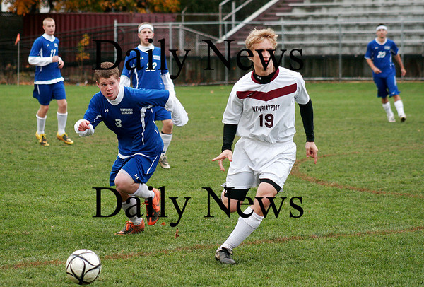 Newburyport: Kyle Uhlig (19) passes the ball off to a teammate during as the Clippers defeated Methuen at World War Memorial Stadium, 1-0. Photo by Ben Laing/Staff Photo