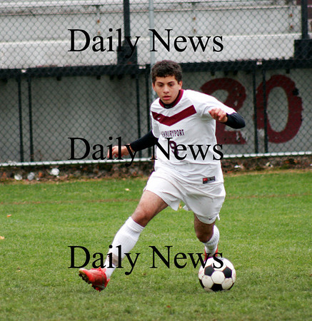 Newburyport: Yazid Eideh (9) of Newburyport carries the ball downfield as the Clippers defeated Methuen 1-0 Monday afternoon at World War Memorial Stadium. Photo by Ben Laing/Staff Photo