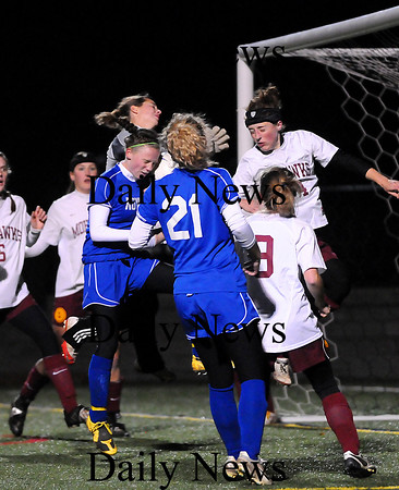 Quincy: Georgetown's Casey Decareau (5) collides with Millis' goalkeeper Amanda White while trying to head the ball into the net early in Tuesday night's Eastern Mass Final in Quincy. The Royals fell to Millis, 1-0. Photo by Ben Laing/Staff Photo