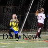 Quincy: Georgetown goalkeeper Jamie Block makes a save on an attempted shot by Millis during Tuesday night's Eastern Mass. State Final game in Quincy. Photo by Ben Laing/Staff Photo