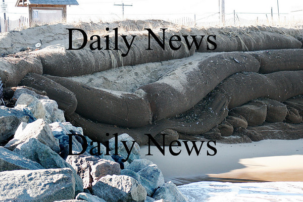 Newbury: The sandbags at Plum Island Center took another beating over the weekend, damaging a section near the groin. Photo by Ben Laing/Staff Photo