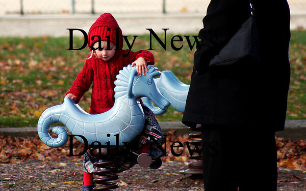 Newburyport: Genevieve Young, 3, of Newbury, climbs onto a seahorse at Cashman Park in Newburyport Monday afternoon. Photo by Ben Laing/Staff Photo