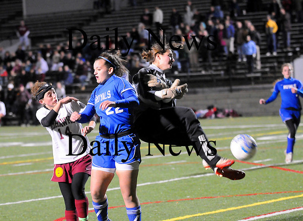 Quincy: Kassandra Barba (22) of Georgetown collides with Millis goalkeeper Amanda White while fighting for a ball in the box during Tuesday night's 1-0 defeat in the Eastern Mass State Final in Quincy. Photo by Ben Laing/Staff Photo