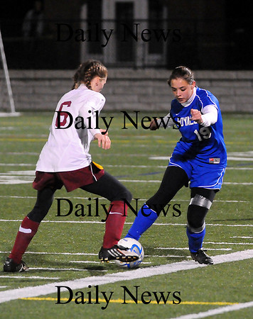 Quincy: Emma Cannon (19) dribbles around a Millis defender during Tuesday night's Eastern Mass. State Final game in Quincy. Photo By Ben Laing/Staff Photo
