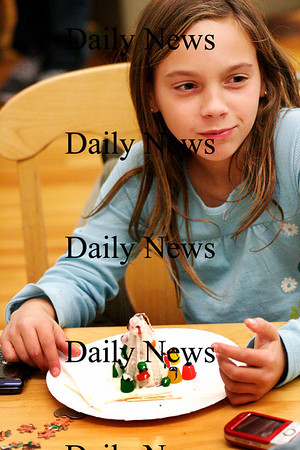 Newburyport: Michelle Thibault, 11, of Newburyport, eats a snack she made at the Kelley School Youth Center Thursday afternoon. The kids made snacks from ice cream cones and other sweet treats. Photo by Ben Laing/Staff Photo