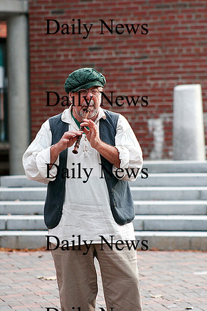 Newburyport: Jack Garvey performs on Inn Street in downtown Newburyport Tuesday afternoon, playing his flute for passerby's. Photo by Ben Laing/Staff Photo