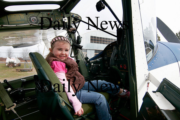 """Newbury: Shaelin Lombard, 4, of Newburyport, sits in the cockpit of a airplane at the Plum Island airfield Tuesday morning. Shaelin and other children were visiting the airfield as part of the Spencer-Pierce-Little Farm's """"Farm Friends""""  program. Photo by Ben Laing/Staff Photo"""