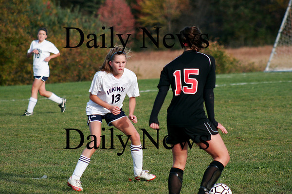 Byfield: Jillian Gallagher (13) of Triton defends a North Andover player during Wednesday's game in Byfield. Photo by Ben Laing/Staff Photo