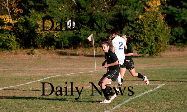 Georgetown: Georgetown's Kelly Chickering (2) heads a ball on goal as two North Andover defenders look on during Monday's game. Photo by Ben Laing/Staff Photo