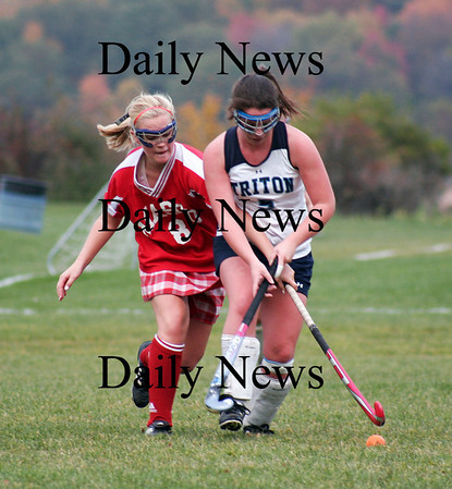 Byfield: Triton's Colleen Mills (5) battles a Masconomet player for a loose ball during Wednesday's game in Byfield. Photo by Ben Laing/Staff Photo