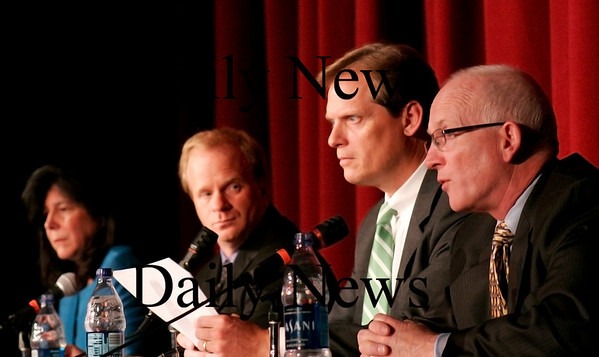 Newburyport: James Shanley, right, answers a question from moderators Chuck Withee and John Macone during Wednesday night's mayoral debate with Donna Holladay, left. Photo by Ben Laing/Staff Photo