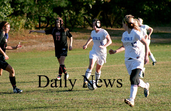 Georgetown: Casey Decaareau (5) looks to pass to her teammate Nicoline Holland (17) as Georgetown took on North Andover Monday afternoon. Photo by Ben Laing/Staff Photo