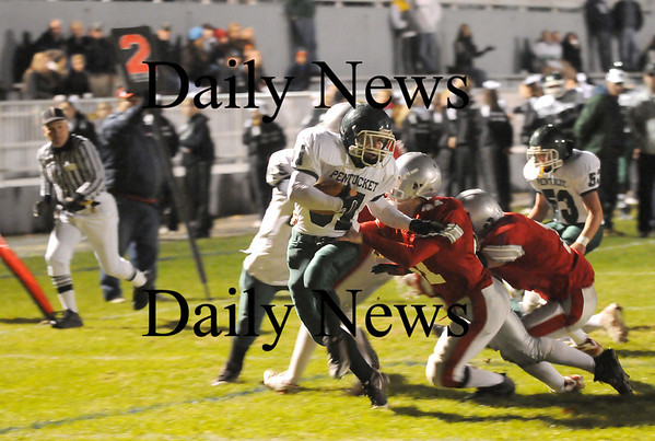 Amesbury: Pentucket running back Austin Perreault (31) breaks a tackle from Amesbury's Mark Sweazey (41) on his way to the end zone for the Sachems first touchdown during Friday night's game at Landry Stadium. Photo by Ben Laing/Staff Photo
