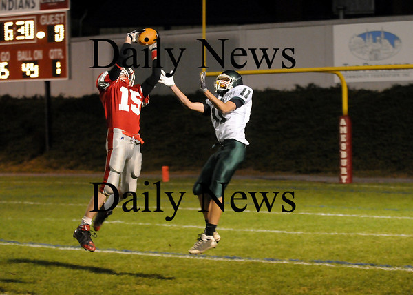 Amesbury: Tyler Lay (15) intercepts a Mike Doud pass intended for John Modlish (11) of Pentucket early in the first quarter of Friday's game in Amesbury. Photo by Ben Laing/Staff Photo