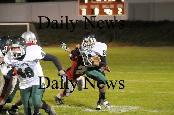 Amesbury: C.J. Lataille (24) shrugs off an Amesbury tackler as Pentucket faced the Indians at Landry Stadium Friday night. Photo by Ben Laing/Staff Photo