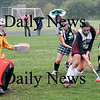 Newburyport: Cassaundra Davis (13) of Newburyport fires a backhanded shot on the goal keeper of Manchester-Essex during Friday afternoon's game at Fuller Field. Photo by Ben Laing/Staff Photo