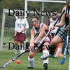 Newburyport: Sophmore Kelsey Crowley (4) of Newburyport fights for a loose ball in Friday afternoon's game against Manchester-Essex. Photo by Ben Laing/Staff Photo