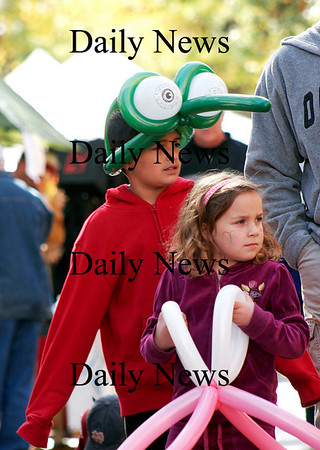 Newburyport: Shawn Hussey, 9, of Amesbury wears a balloon hat as he walks with his sister and parents down Inn Street in Newburyport during Monday's Harvest Festival. Photo by Ben Laing/Staff Photo