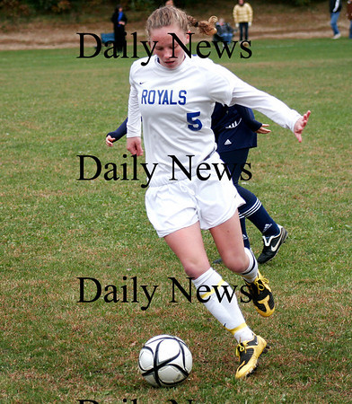 Georgetown: Casey Decareau (5) of Georgetown moves the ball past a Wilmington defender Friday afternoon as the Royals went on to win 1-0. Photo by Ben Laing/Staff Photo