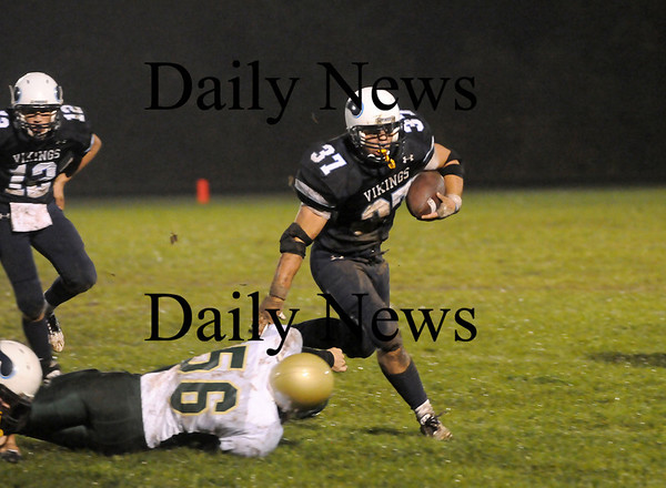 Byfield: Triton running back Brendan O'Neil (37) sprints around the North Reading defense during Friday night's game in Byfield. Photo by Ben Laing/Staff Photo