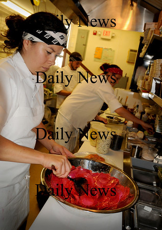 Newburyport: Chef Leah Dubois mixes up marinated watermelon rind relish with spices at Grezzo on State Street in Newburyport. Bryan Eaton/Staff Photo