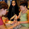 Amesbury: Seismologist Leslie Campbell from the Weston Observatory was in Gale Regis' class at Amesbury Middle School working with students who designed their own seismographs. Working on their project are, from left, Phoebe Winders, 11, Hajra Hanif, 12, and Alissa Smith, 11. Bryan Eaton/Staff Photo