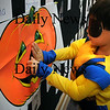 Newbury: Ryan Nguyen, 5, dressed as a Wolverine, puts the nose on a jack-o-lantern while blindfolded at Newbury Elementary School on Thursday morning. The afternoon kindergartners were having their Halloween party a day early as they have no class this afternoon. Bryan Eaton/Staff Photo