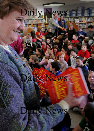 Amesbury: Lorraine Sanborn hands dictionaries to third-graders at Amesbury Elementary School on Thursday morning. Several members of the Rotary Club, of which she's a member, handed out the books--whcih they do every year--also to students of the Cashman School Bryan Eaton/Staff Photo