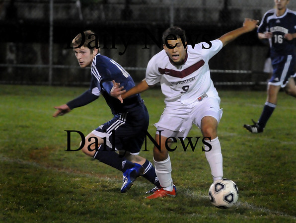 Newburyport: Clipper's Yazid Eideh moves the ball past a Wilmington player in soccer action last night. Bryan Eaton/Staff Photo