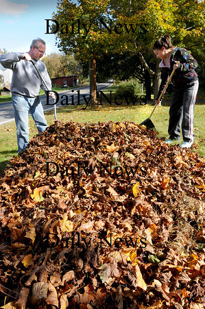 Amesbury: Alissa Smith, 11, helps her father Arthur rake up the heavy load of leaves at their Kimall Road, Amesbury home Wednesday afternoon. Her mother, Maureen, out of view, also joined in the fall family affair. Bryan Eaton/Staff Photo