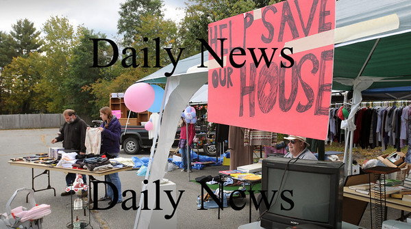 Salisbury: Bill Ralston and daughter, Rebecca, have received donations to help raise money to forego a foreclosure on their Hayes Street home. They've set up goods to sell at the yard sale outside Tom's Discount on Route 110 in Salisbury. Bryan Eaton/Staff Photo