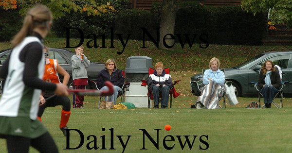 West Newbury: Summer is certainly over as spectators to Ipswich High at Pentucket's field hockey game were bundled up yesterday afternoon. Bryan Eaton/Staff Photo
