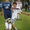 Newburyport: Newburyport's Yazid Eideh (9) tries to get the ball from Triton's Dan Ford. Bryan Eaton/Staff Photo