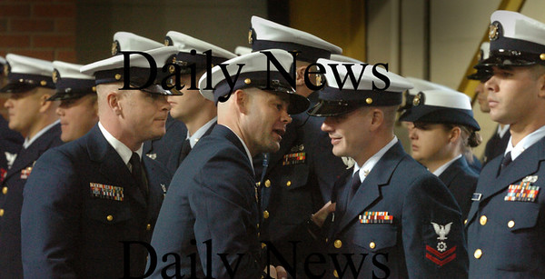 Newburyport: Senior Chief Boatswain's Mate Brent Zado, center, inspects the crew at U.S. Coast Guard Station Merrimack, as his replacement, Chief Boatswain's Mate Jason Holm, follows. About 70 people including area officials attended the Change of Command ceremony. Bryan Eaton/Staff Photo