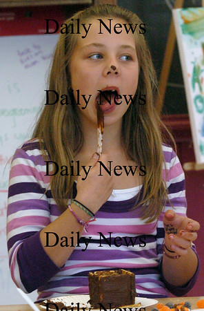 Newburyport: While making Graham cracker haunted houses with chocolate, Savannah Waterworth, 11, got some chocolate on her nose while licking the plastic knife. She was at the Newburyport Youth Services Drop-In Center at the Kelley School. Bryan Eaton/Staff Photo