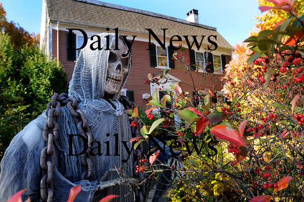 Newburyport: The grim reaper ready to scare at 313 Merrimac Street in Newburyport. Bryan Eaton/Staff Photo