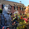 Newburyport: The grim reaper ready to scare at 313 Merrimac Street in Newburyport. Bryan Eaton/Staff Photo