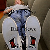 Newburyport: Garth Robinson, 12, talks to some friends while sprawled on one of the couches at the Drop-In Center at the Kelley School on Tuesday afternoon. He said he a busy week and a long day at school so wanted to rest a bit. Bryan Eaton/Staff Photo