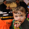 Newburyport: Grayson Driscoll, 2, of Newburyport didn't let rain get in the way of enjoying a chocolate-frosted cupcake yesterday afternoon outside the Montessori School. Parents at the school held a bake sale under two tents to raise money for the Pettengill House Food Pantry. Bryan Eaton/Staff Photo