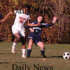 Amesbury: Amesbury Whitney Whitlow fight for the ball against a Wilmington player. Bryan Eaton/Staff photo